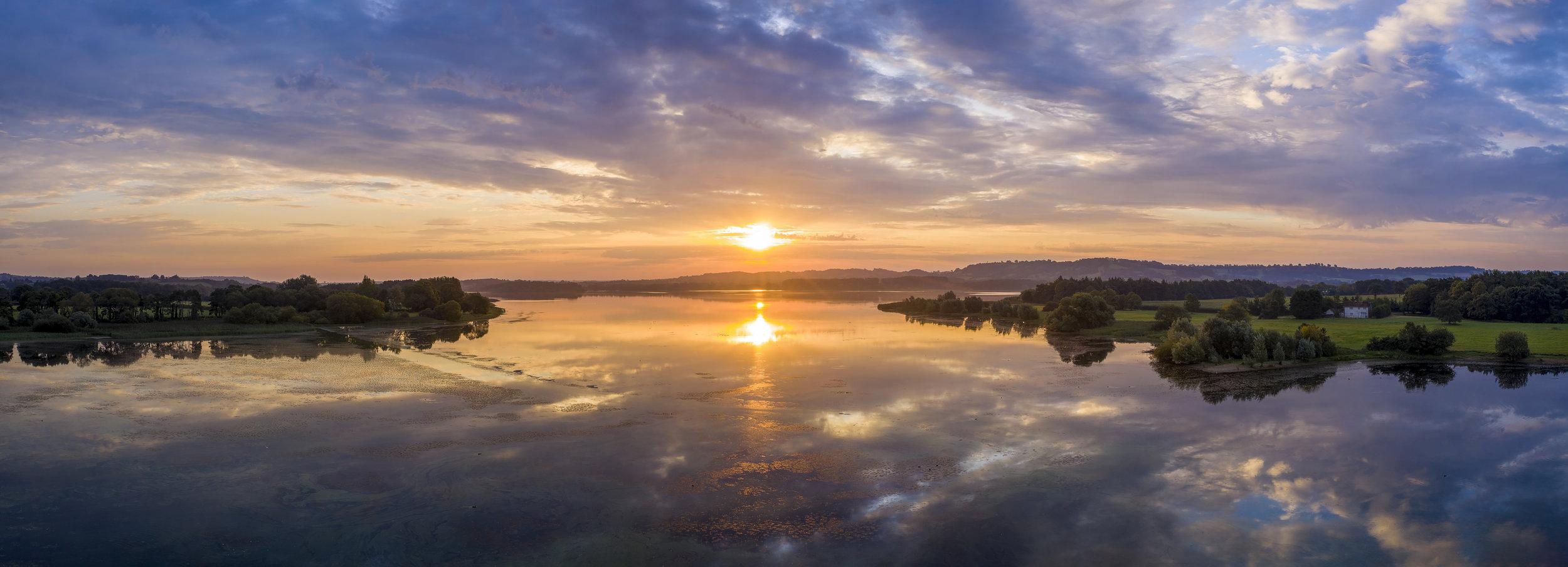Horizontal panoramic sunrise of Chew Valley Lake.