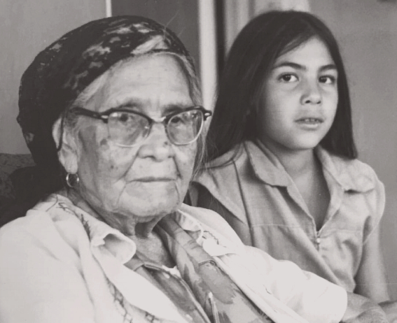 Young Felicia Cocotzin Ruiz with her grandmother •