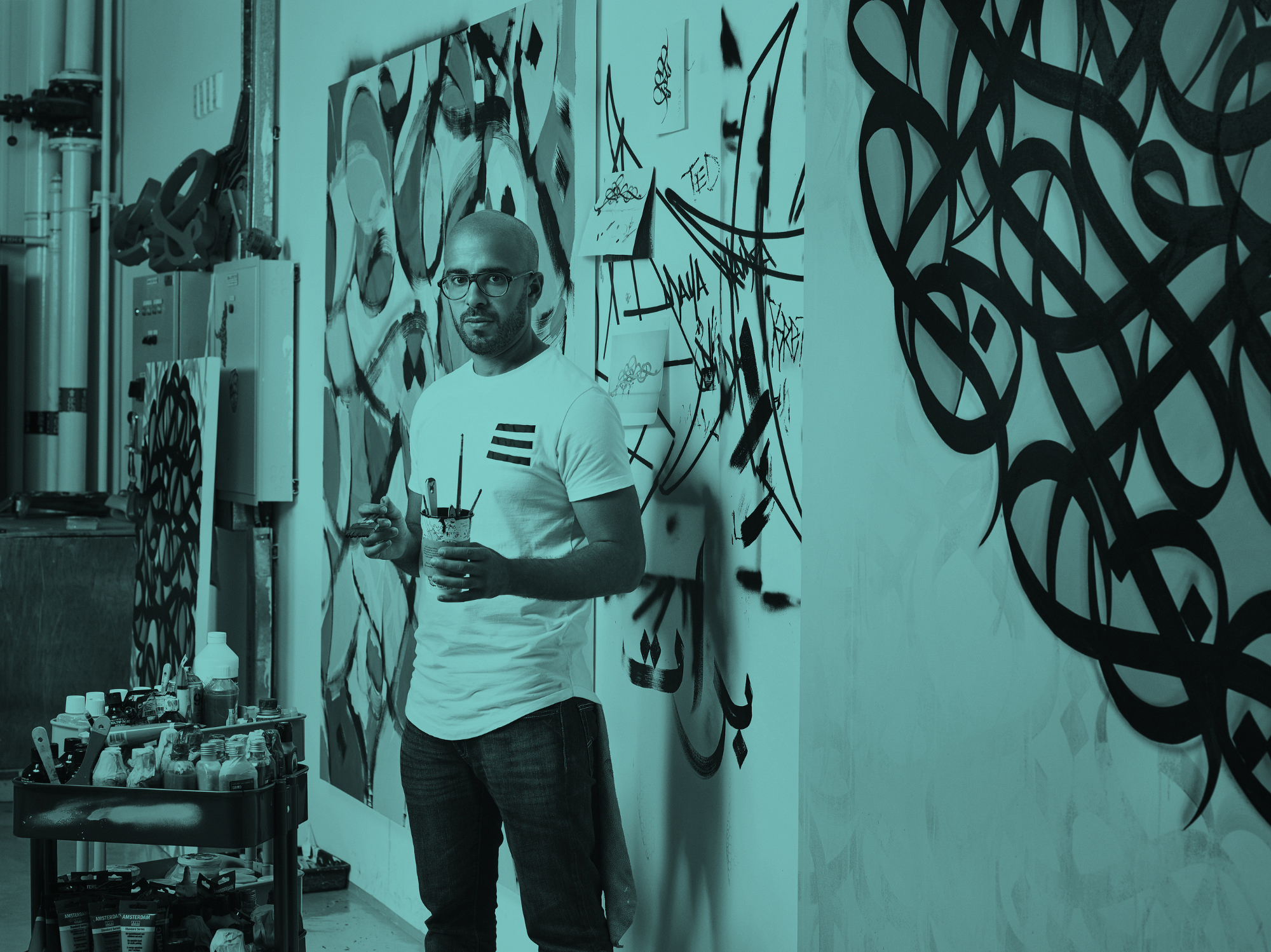 eL Seed - eL Seed is a French-Tunisian contemporary artist, working with Arabic script in 2 and 3 dimensions. He blends the historic art of Arabic calligraphy with graffiti to portray messages of beauty, poetry and peace across all continents. eL Seed is a 2014 TED Fellow, and a 2017 UNESCO Sharjah Prize for Arab Culture recipient.SEE WORK