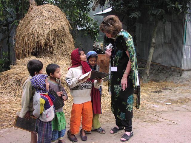 Eager school children showing their work