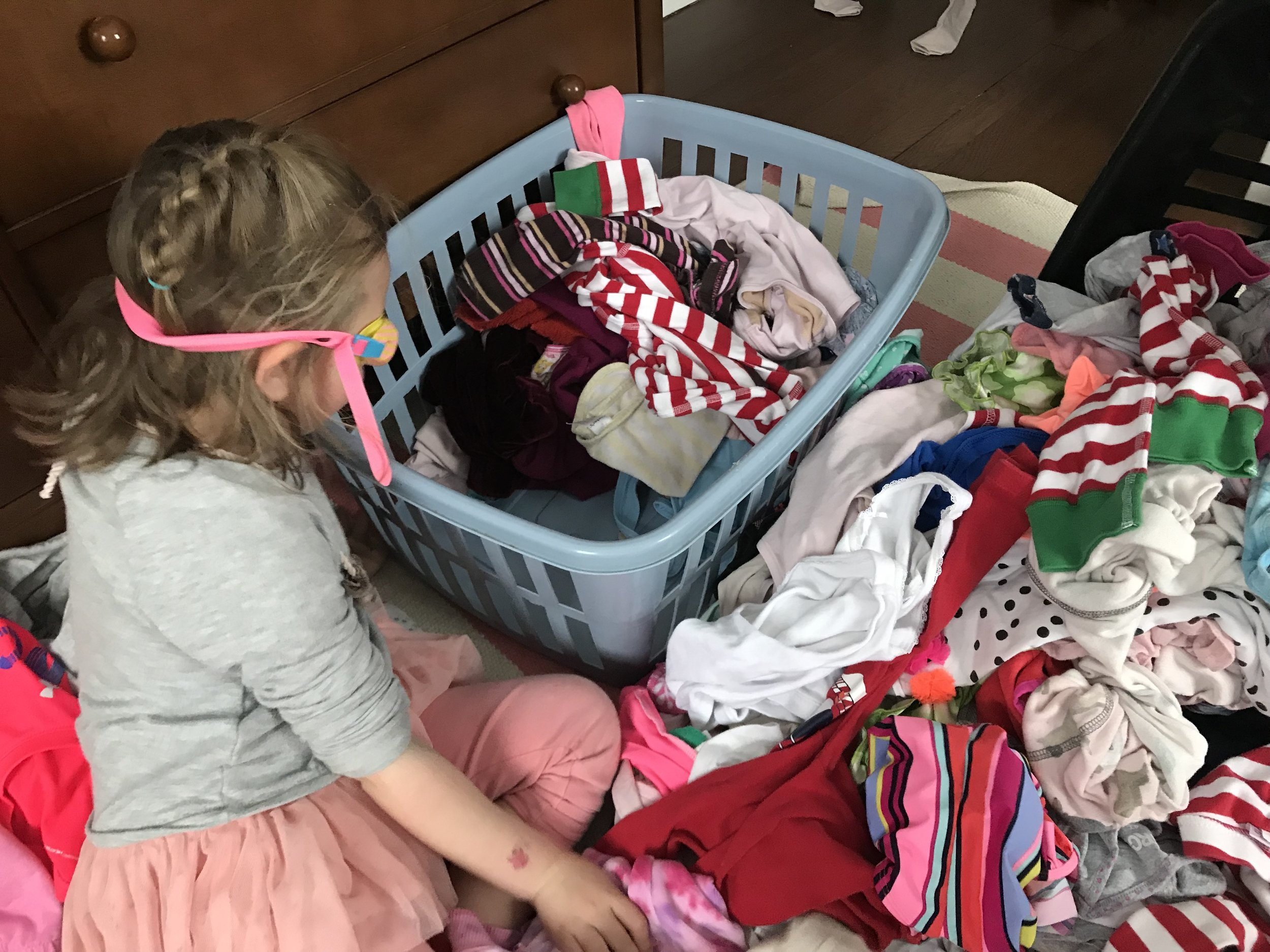 kids file folding laundry