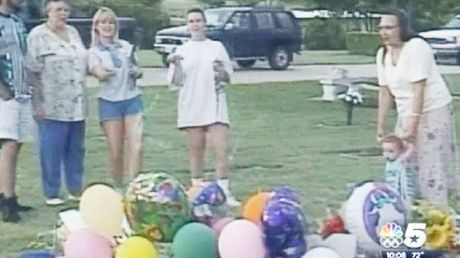 Darlie (in the blue shorts) celebrating Devon's 7th birthday at his grave side in the now infamous silly string video.