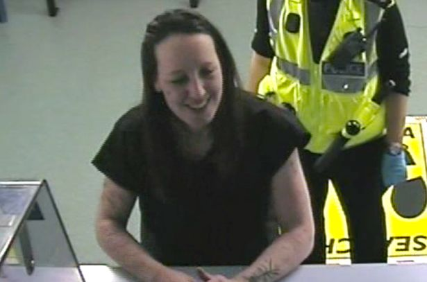 Joanna being booked into the police station.