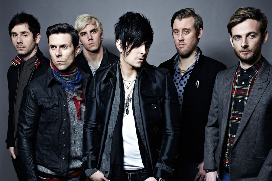 Ian Watkins (centre) with his band mates.