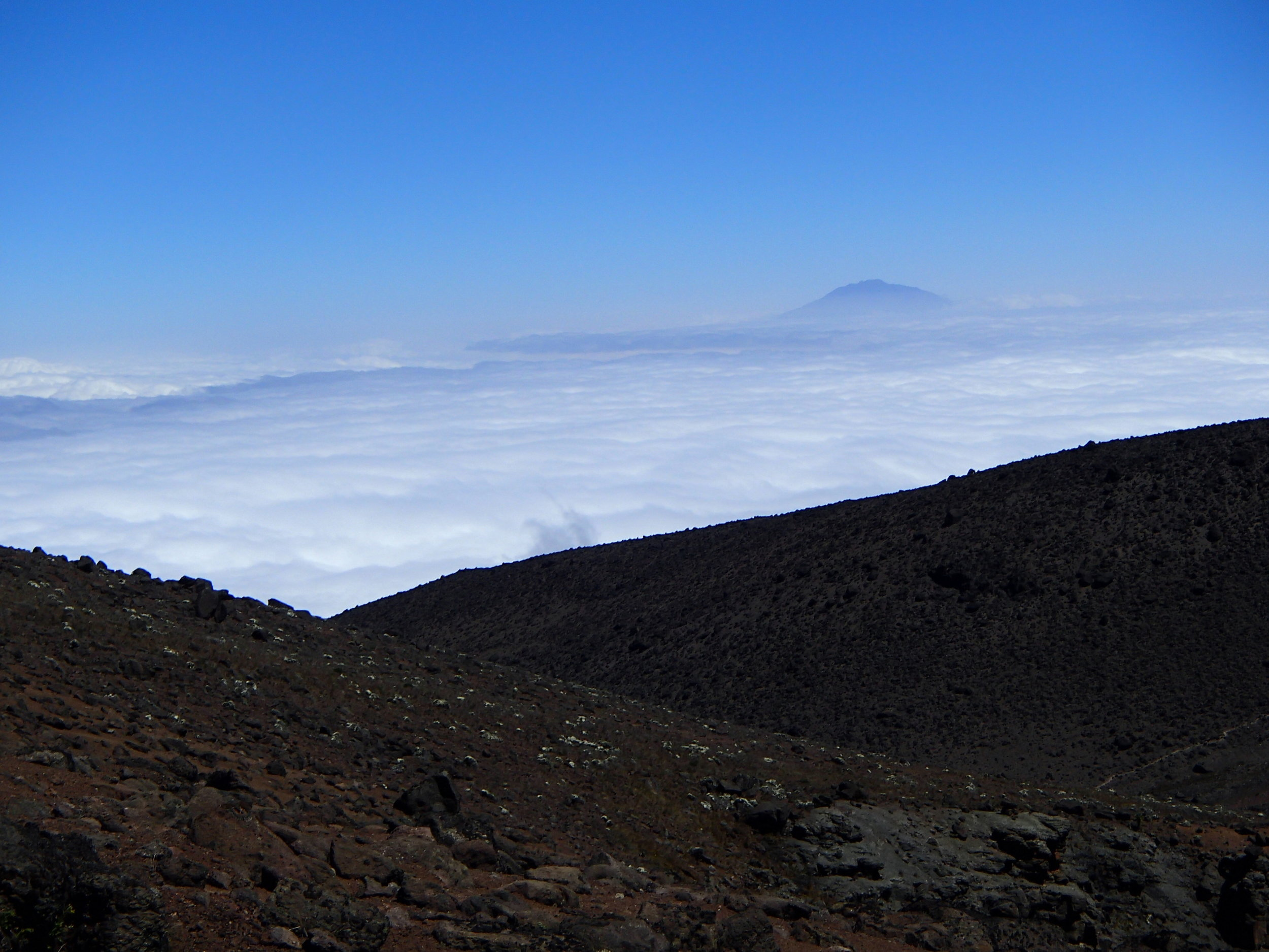 Above the cloud wall.