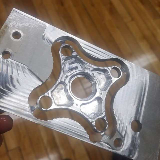 Reduce, reuse, recycle!  Reusing an aluminum fixture plate from a previous part to create a spider.  #instamachinist #cnc #6061