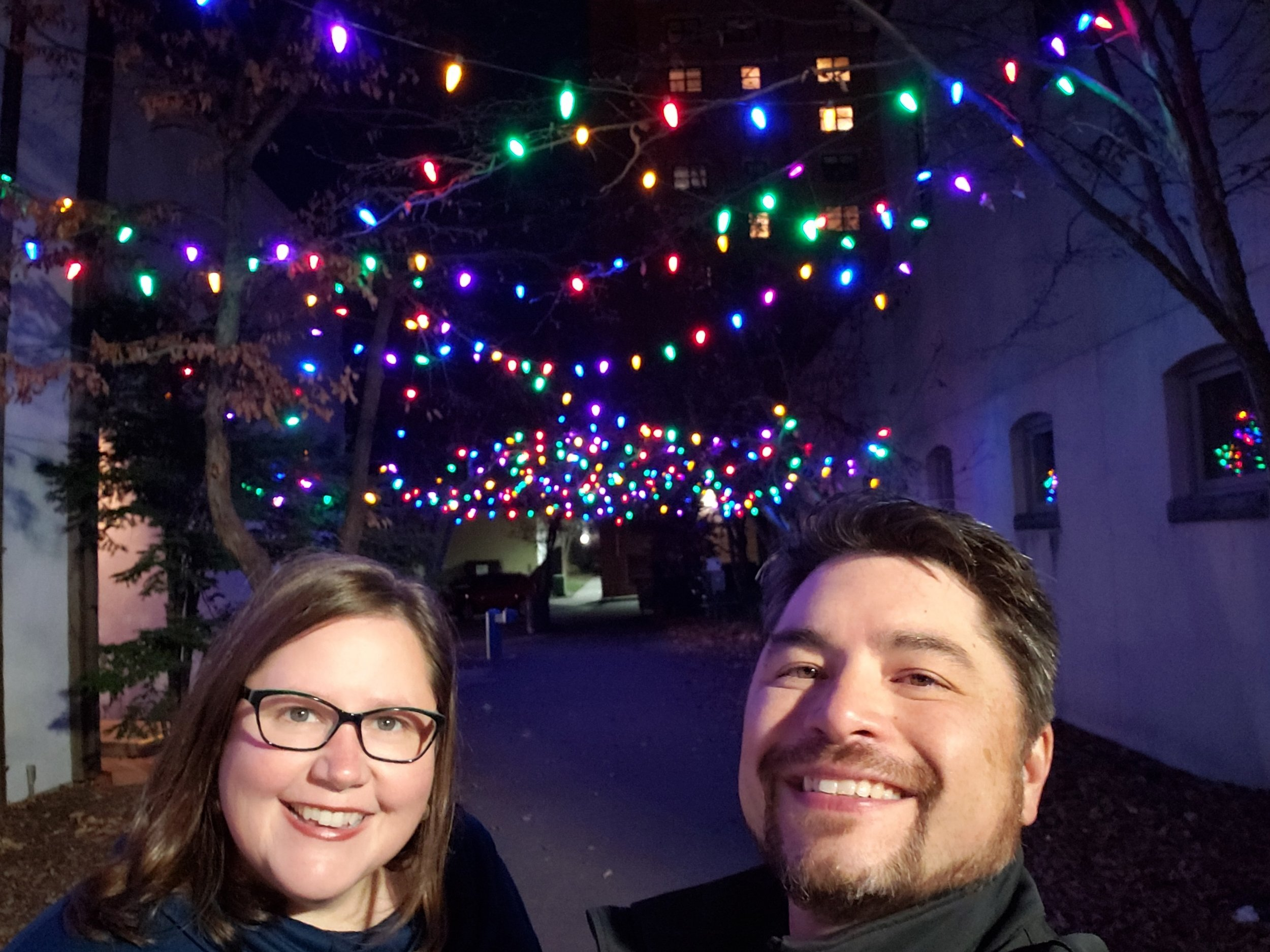 Megan and her husband Kent out enjoying the pretty lights in a courtyard in Red Wing, MN