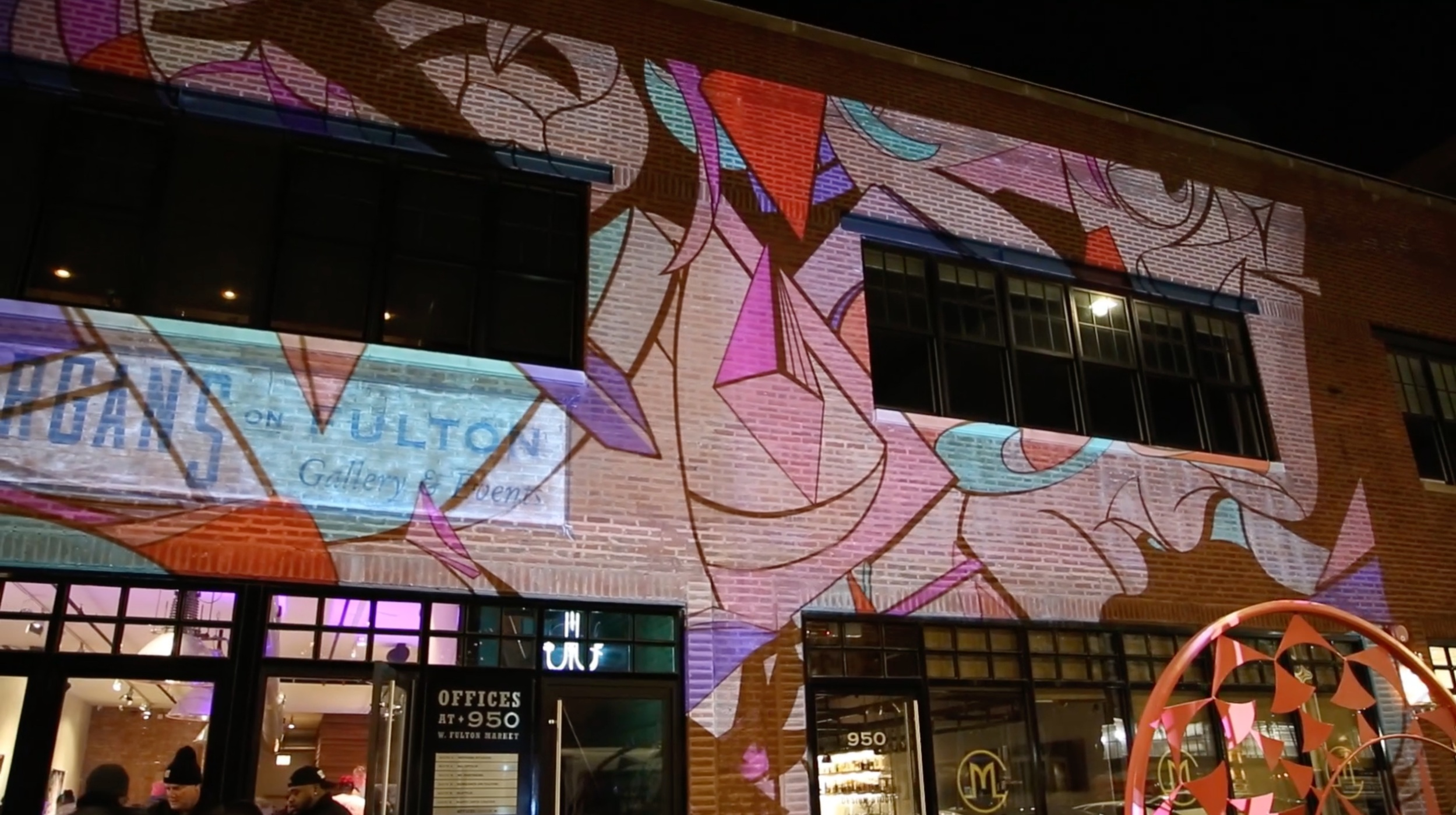 Morgan's on Fulton projection. - Louis DeGuzman Solo Exhibition with art animated by The Mill Chicago.