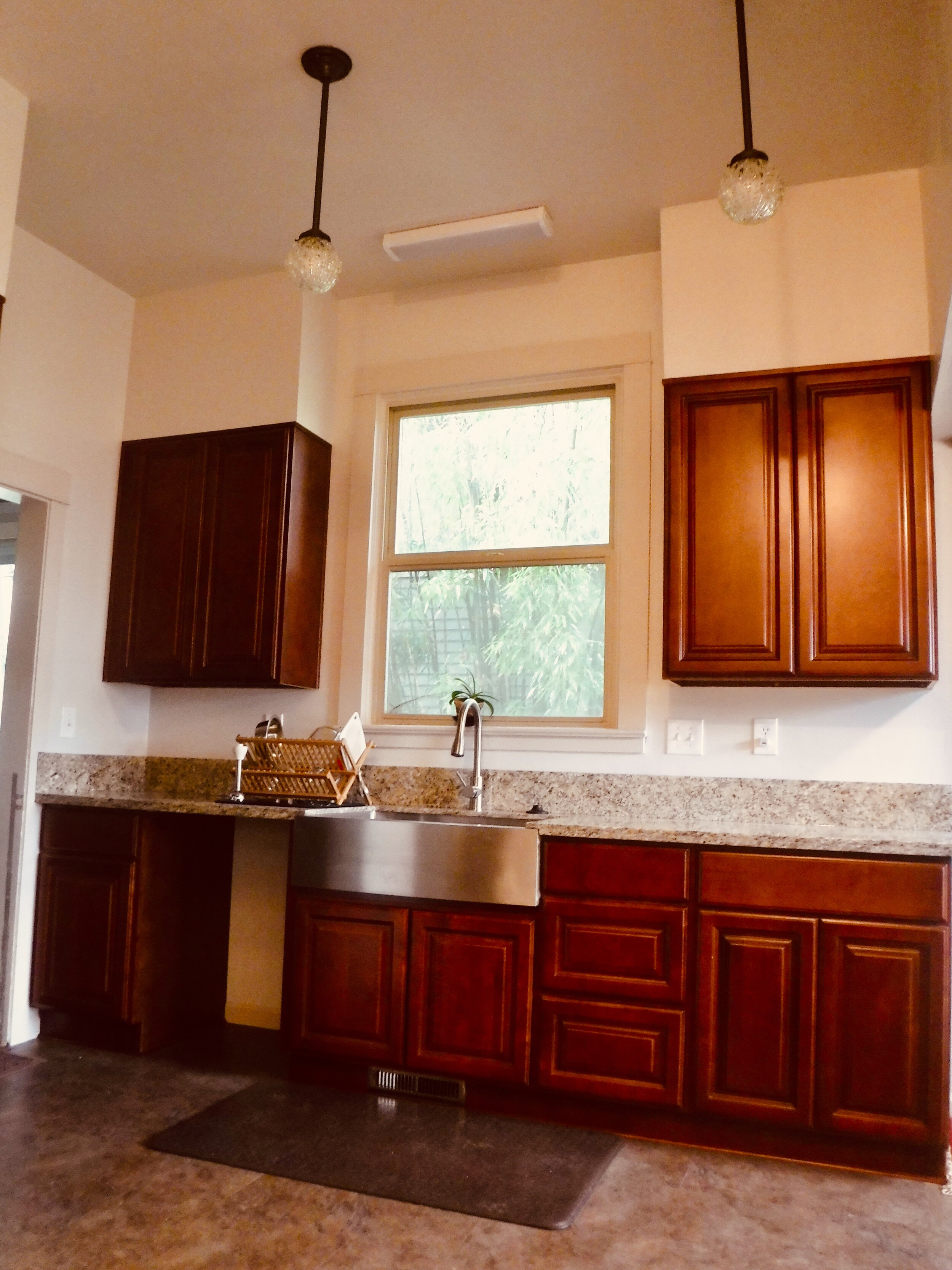 Chocolate cabinetry and Venitian granite brought this kitchen back to life.