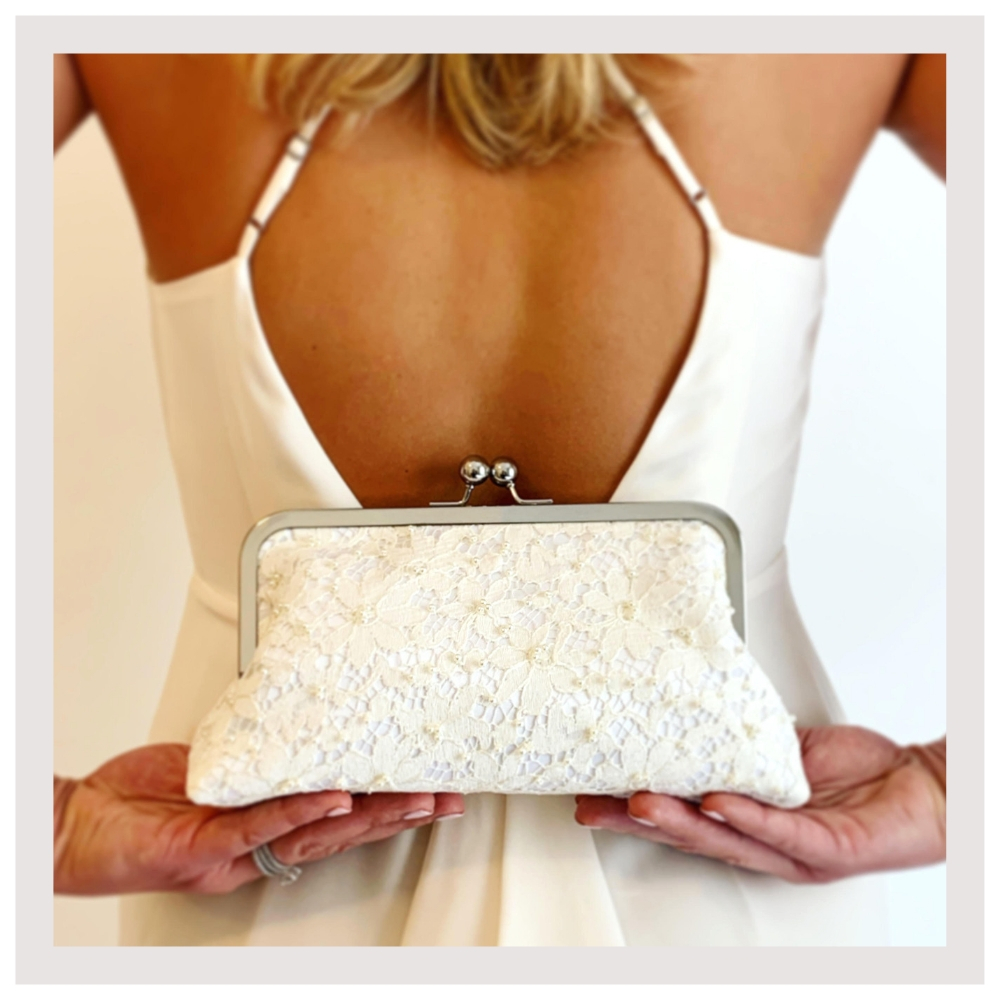 bride with back holding wedding clutch.jpg