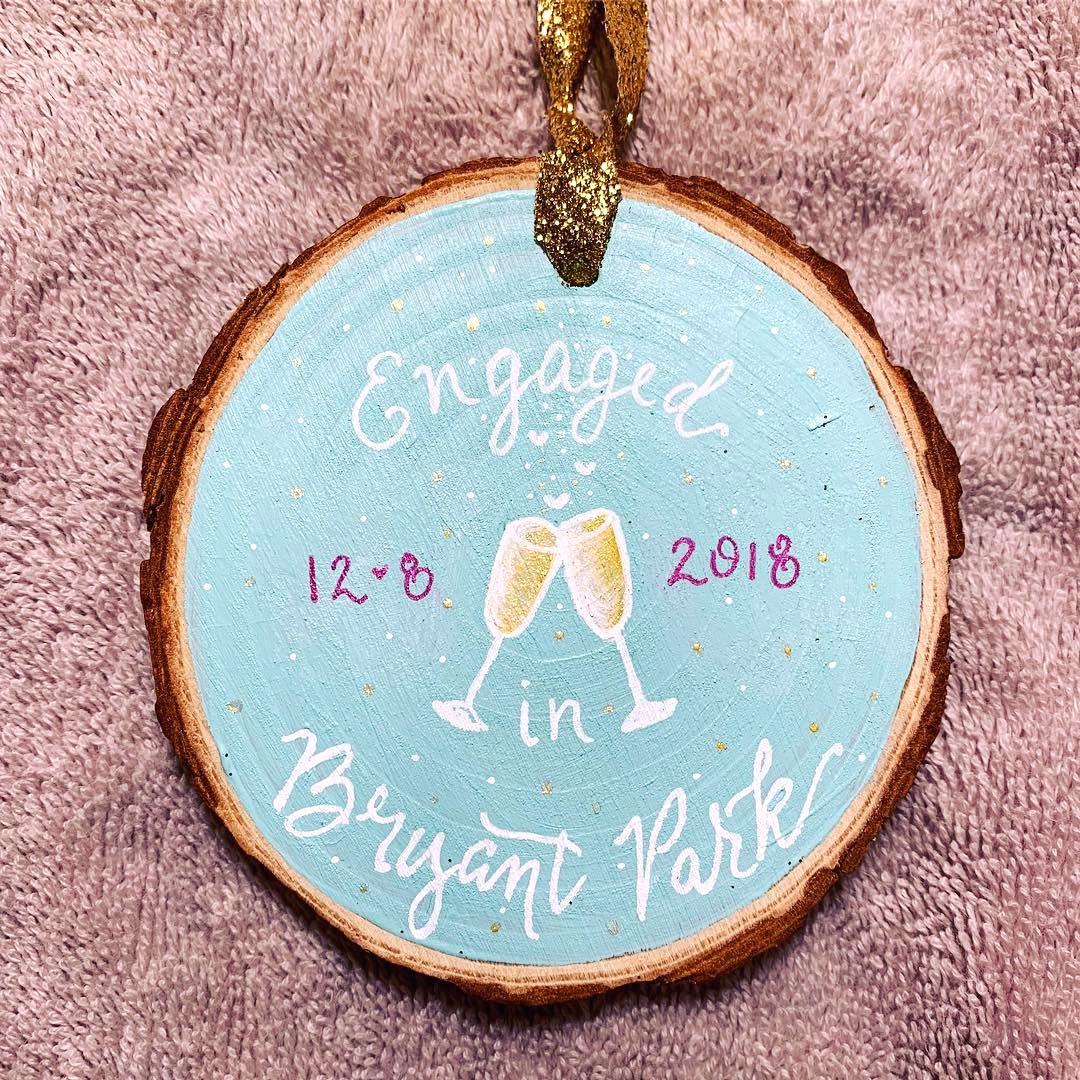 christmas ornament engagement with champagne.jpg