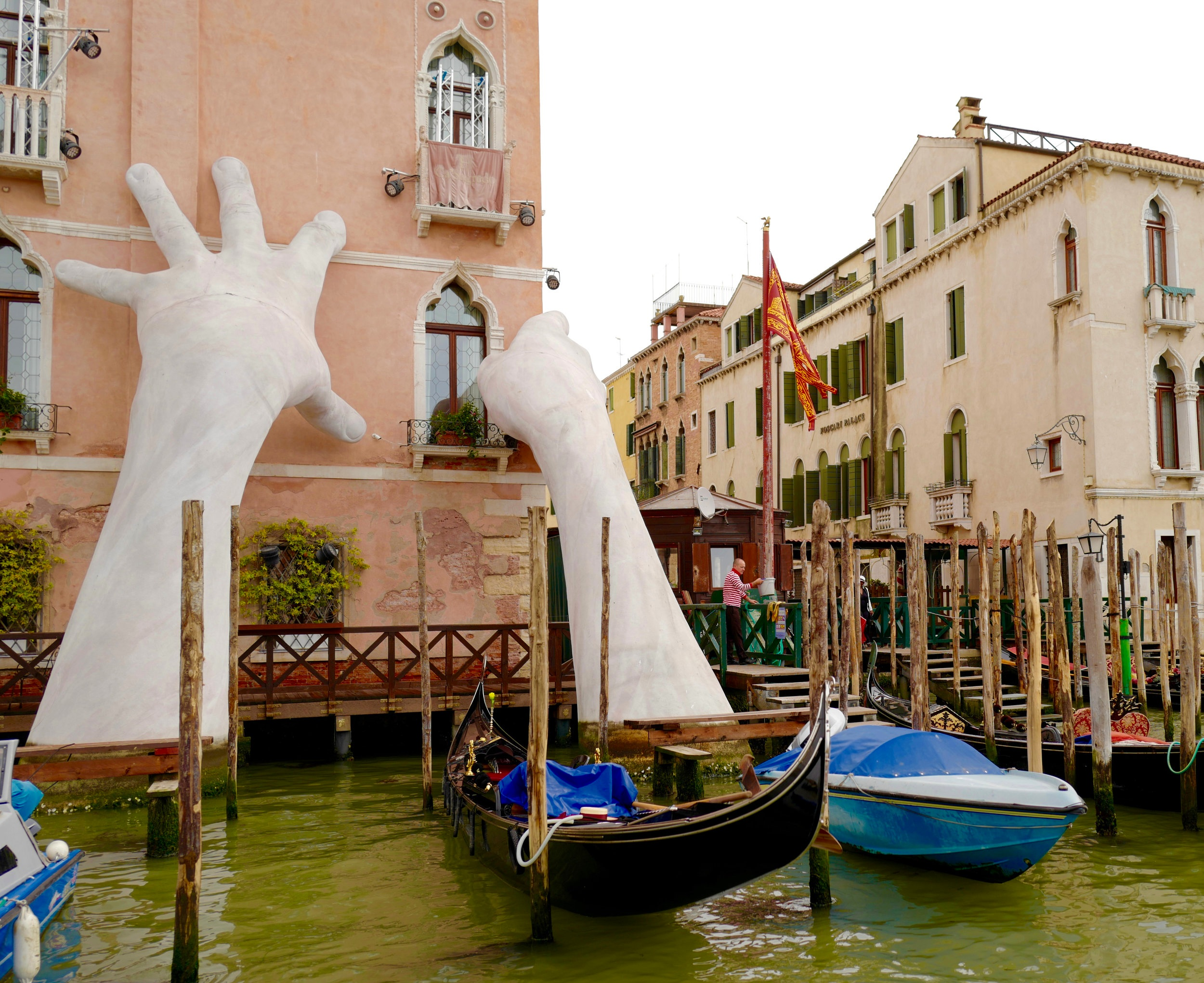 Lorenzo Quinn's  Support  at Venice's Ca' Sagredo Hotel, a worrying remainder about global warming