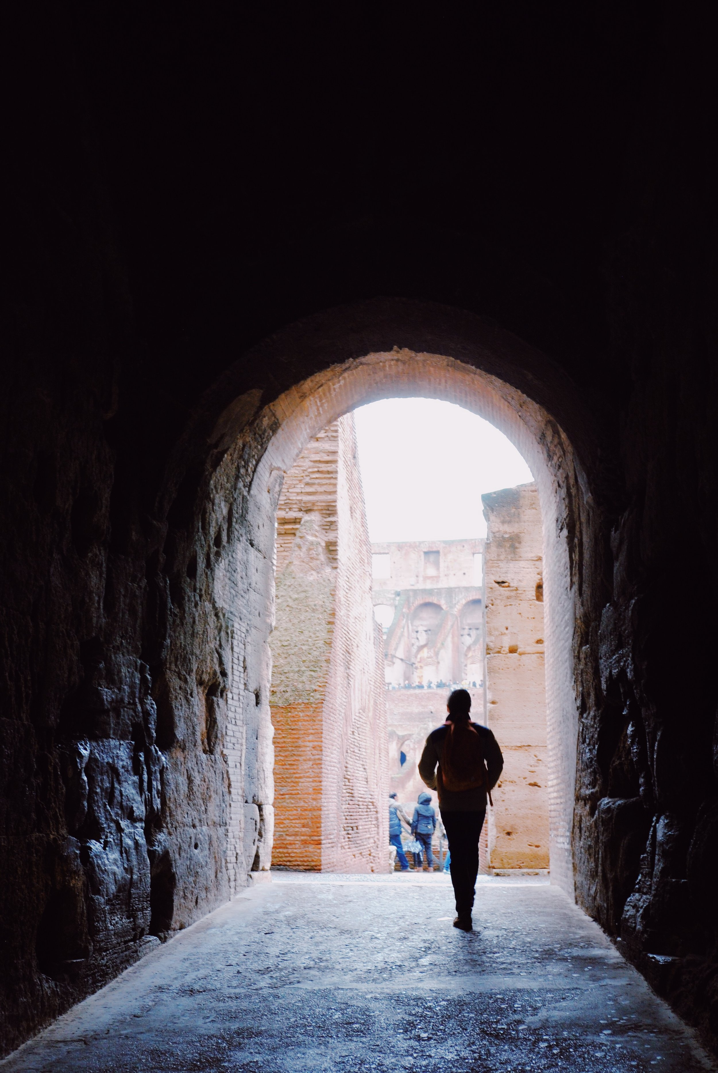 "Inside the Colosseum: Entering via a vomitorium (a passageway through which the crowds could enter). Vomitoria in latin means ""fast discharge"", from which the English word 'vomit' came from."