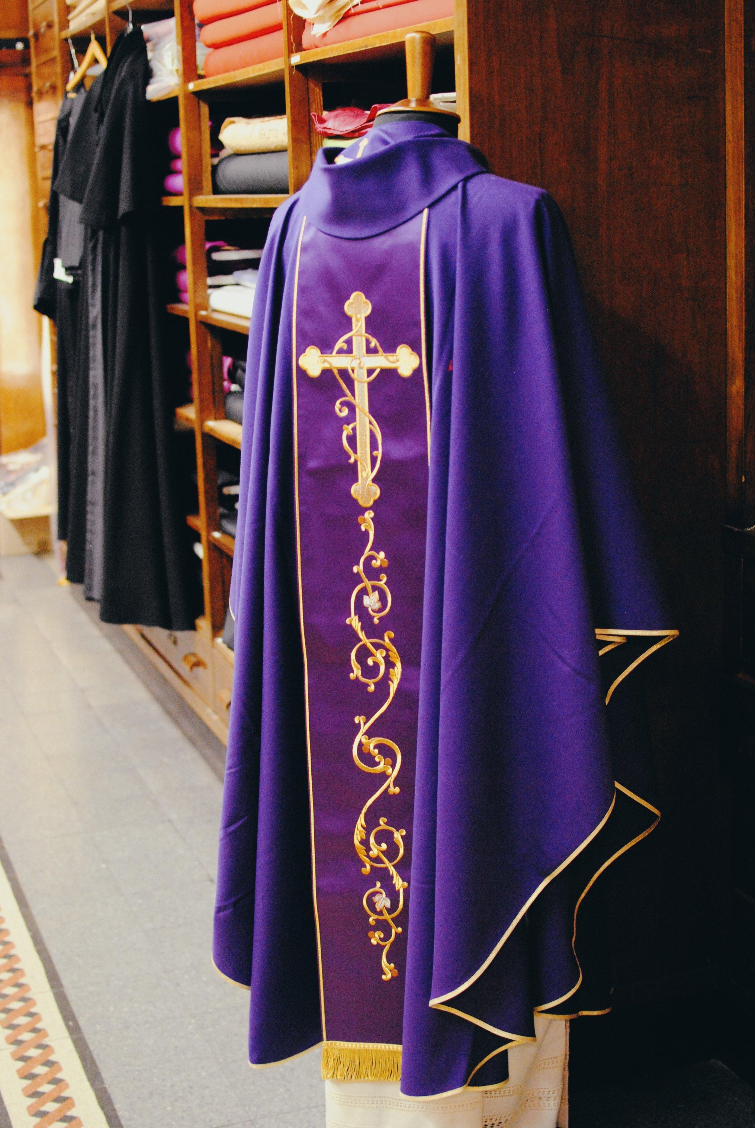 Gammarelli: A beautiful dark purple garment on display in the store.