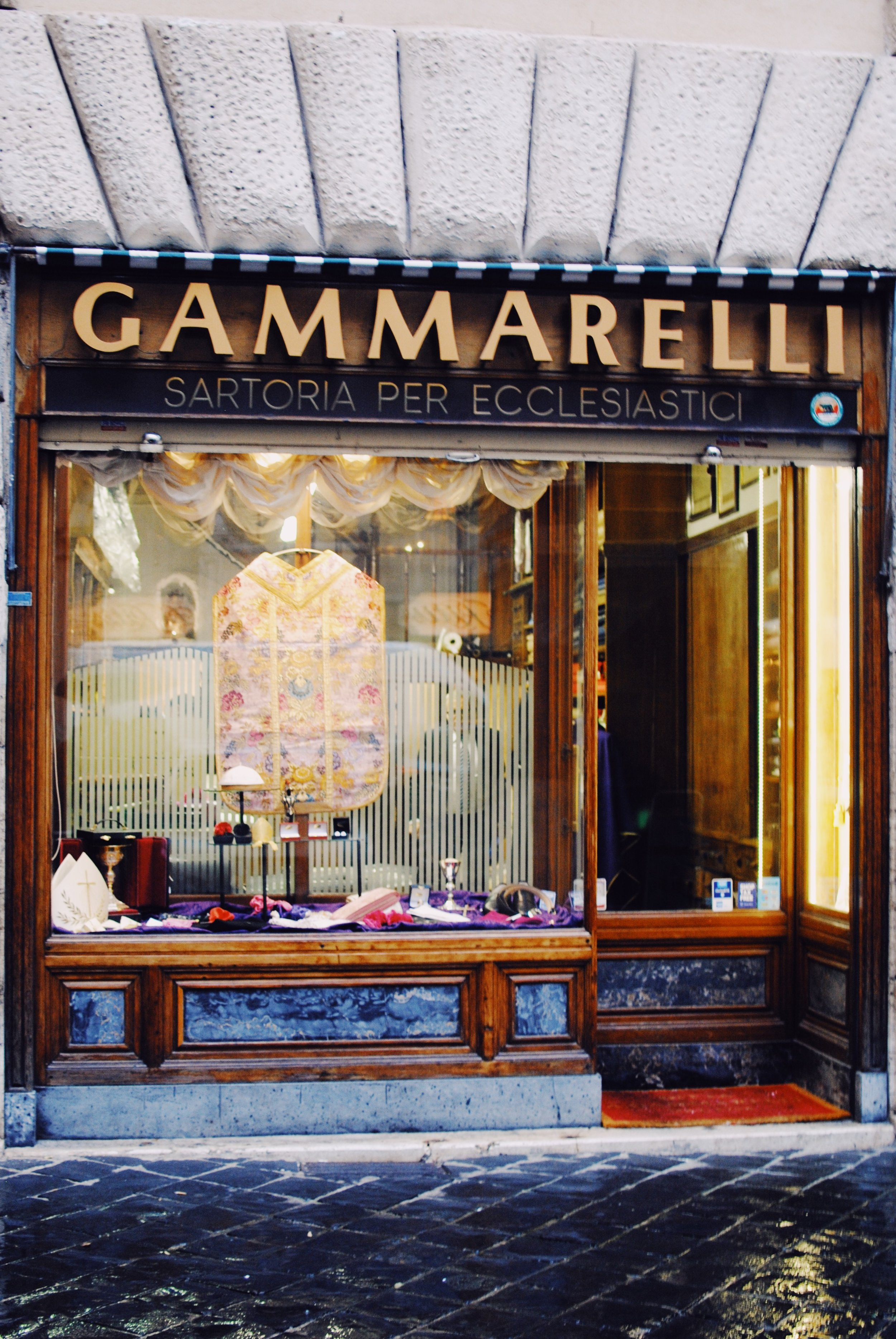 Gammarelli: Storefront. The display will also change depending on what important Catholic event has occurred.
