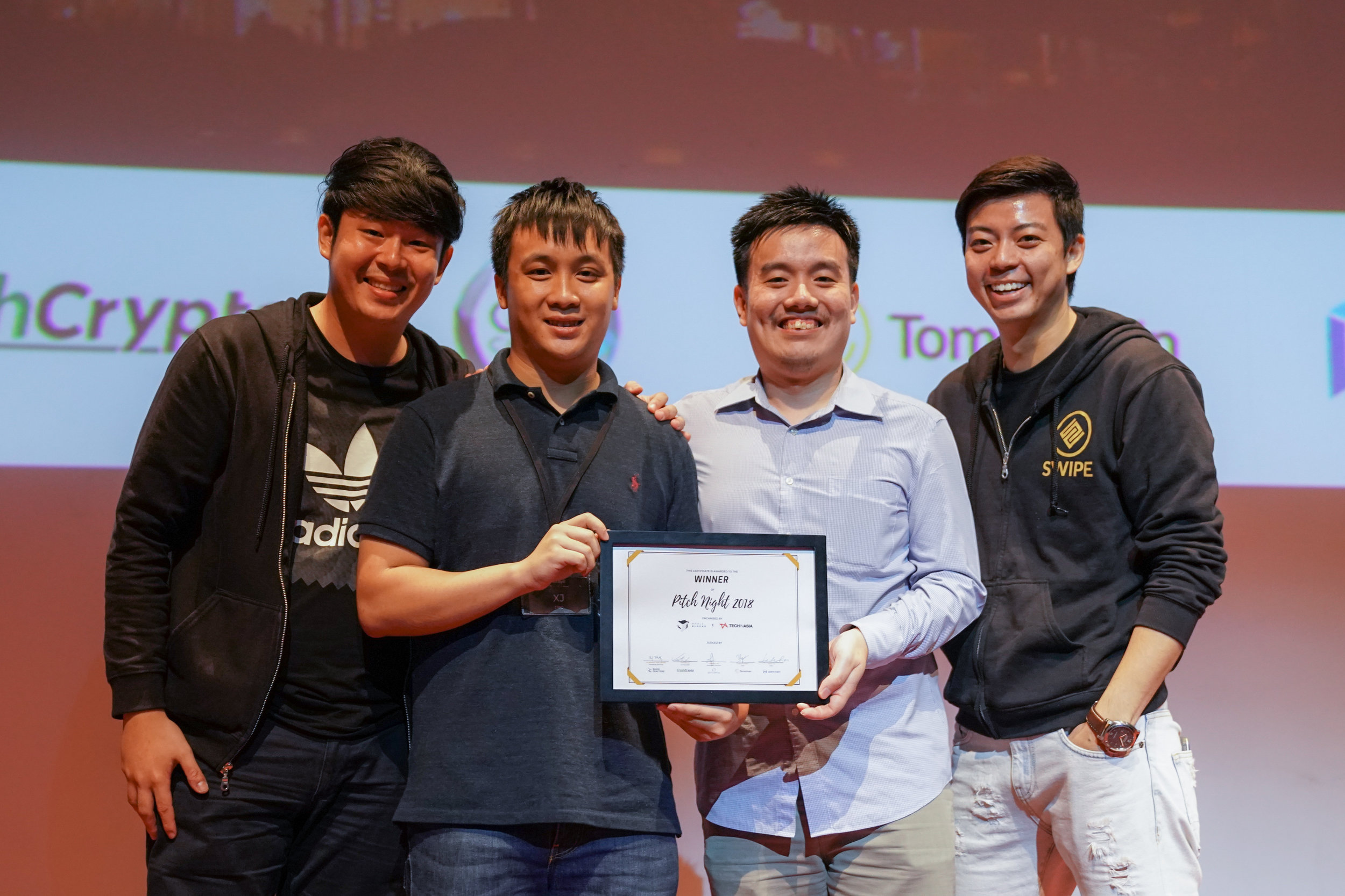 Winners of Pitch Night 2018, the SWIPE team. From left: Malcolm Chang, Pang Xue Jie (COO of WhaleBlocks), Andrew Marchen and Adam Tan.
