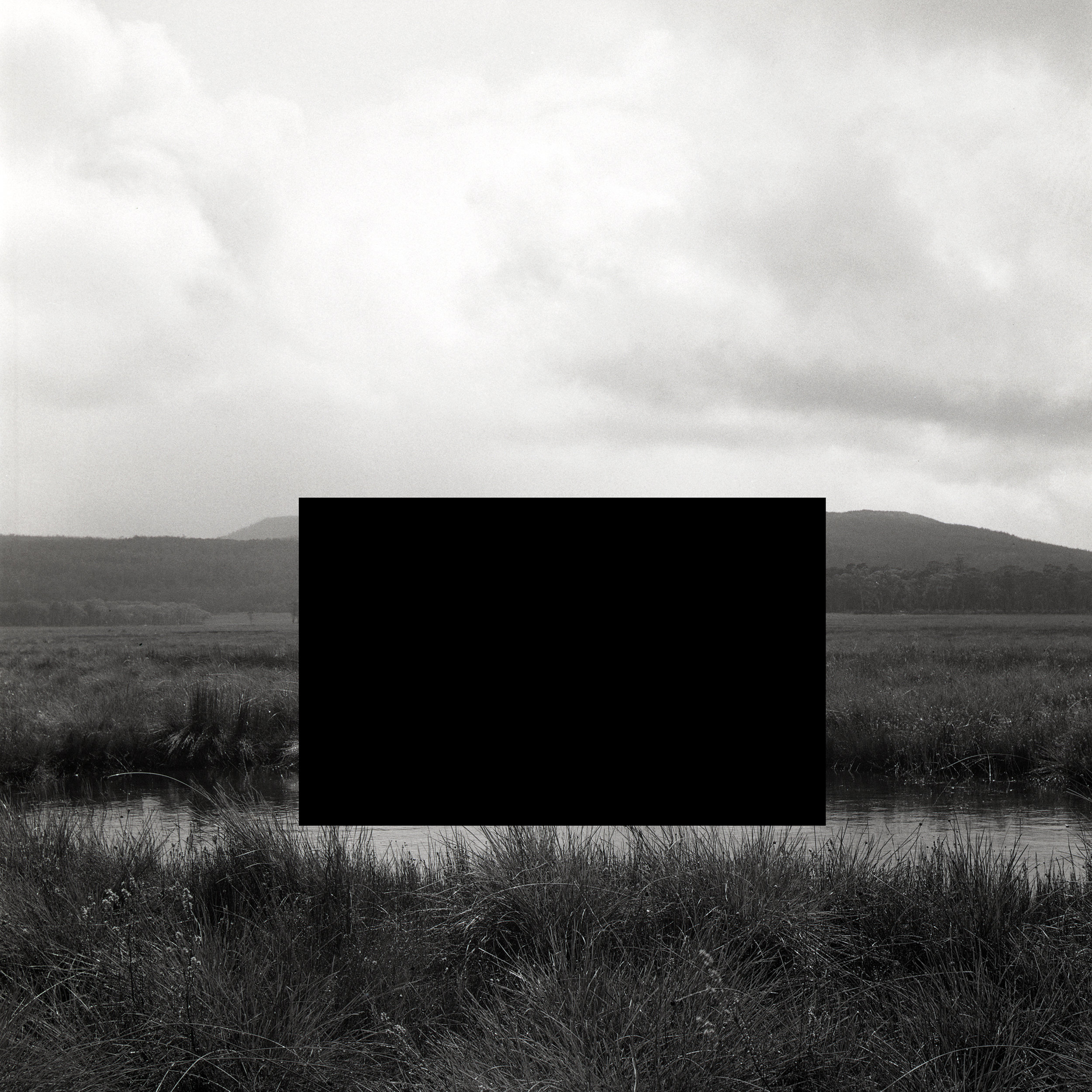 James Tylor ,  (Deleted scenes) From an untouched landscape #13 , 2013.Lake St Clair National Park in Lutruwita Tasmania on Palawa land. Inkjet print on hahnemuhle paper with hole removed to a black velvet void, 60 x 60cm (framed). Courtesy the artist and UTS Art Collection.