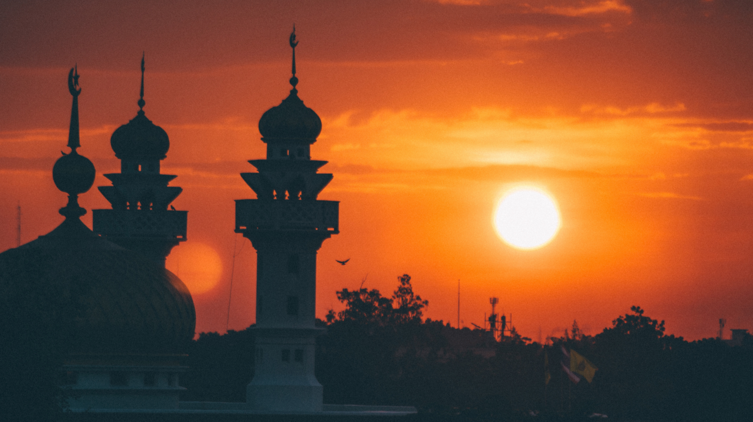 Sun setting over a mosque