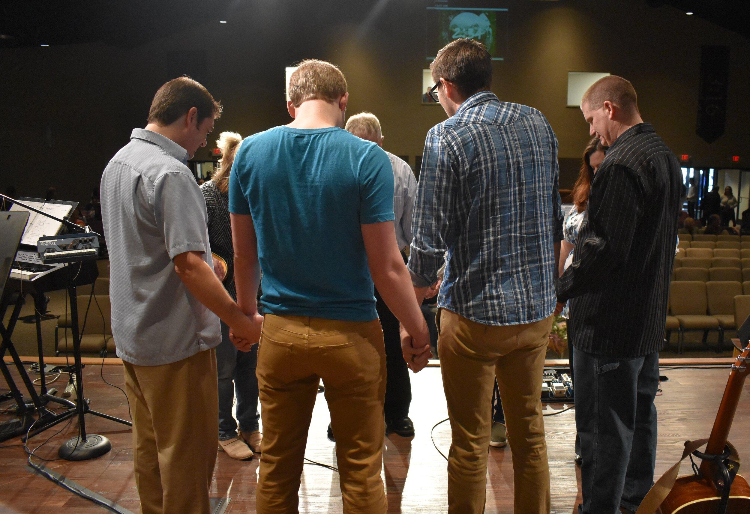 11 team pray (2).JPG
