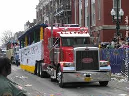 """The Truck Krewes - Rex (and many other parades in the state) is followed by what I actually used to love better as a child (and maybe still do today)- The Truck Krewes. These Big Rig trucks are decorated with love and fun by family and friends who get together to ride on these """"floats"""" on Mardi Gras Day. It's hard to miss them since hundreds of trucks troll continuously for most of Mardi Gras Day!"""
