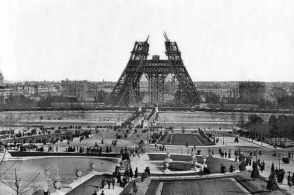 Paris in the 1880s showing the beginnings of the Eiffel Tower