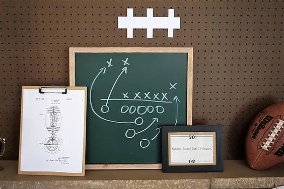 Football decorations with a chalkboard, football patents, and a pegboard turned football.