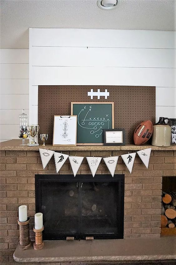 Football decorations on a shiplap mantel