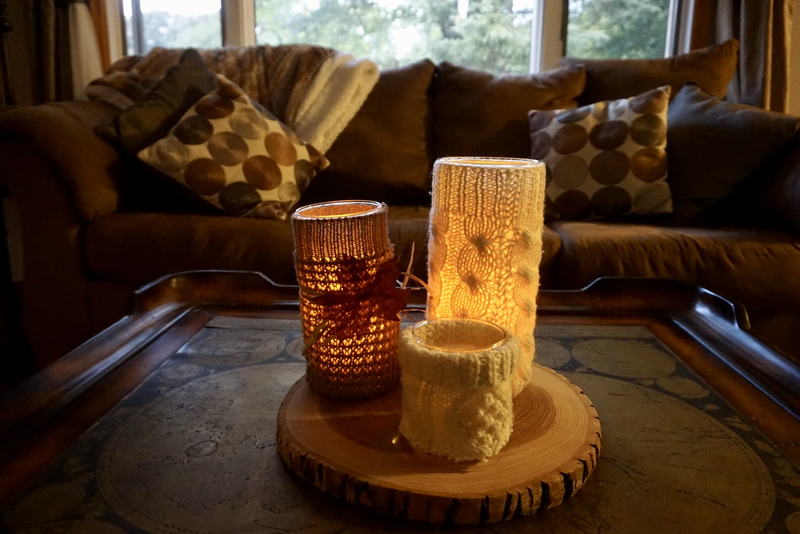 It's time for all things cozy! Click here to learn how to make these NO SEW sweater candles! | Legally Crafty #sweatercandles #diydecor #budgetdecor #fallcrafts #wintercrafts #thriftstoredecor
