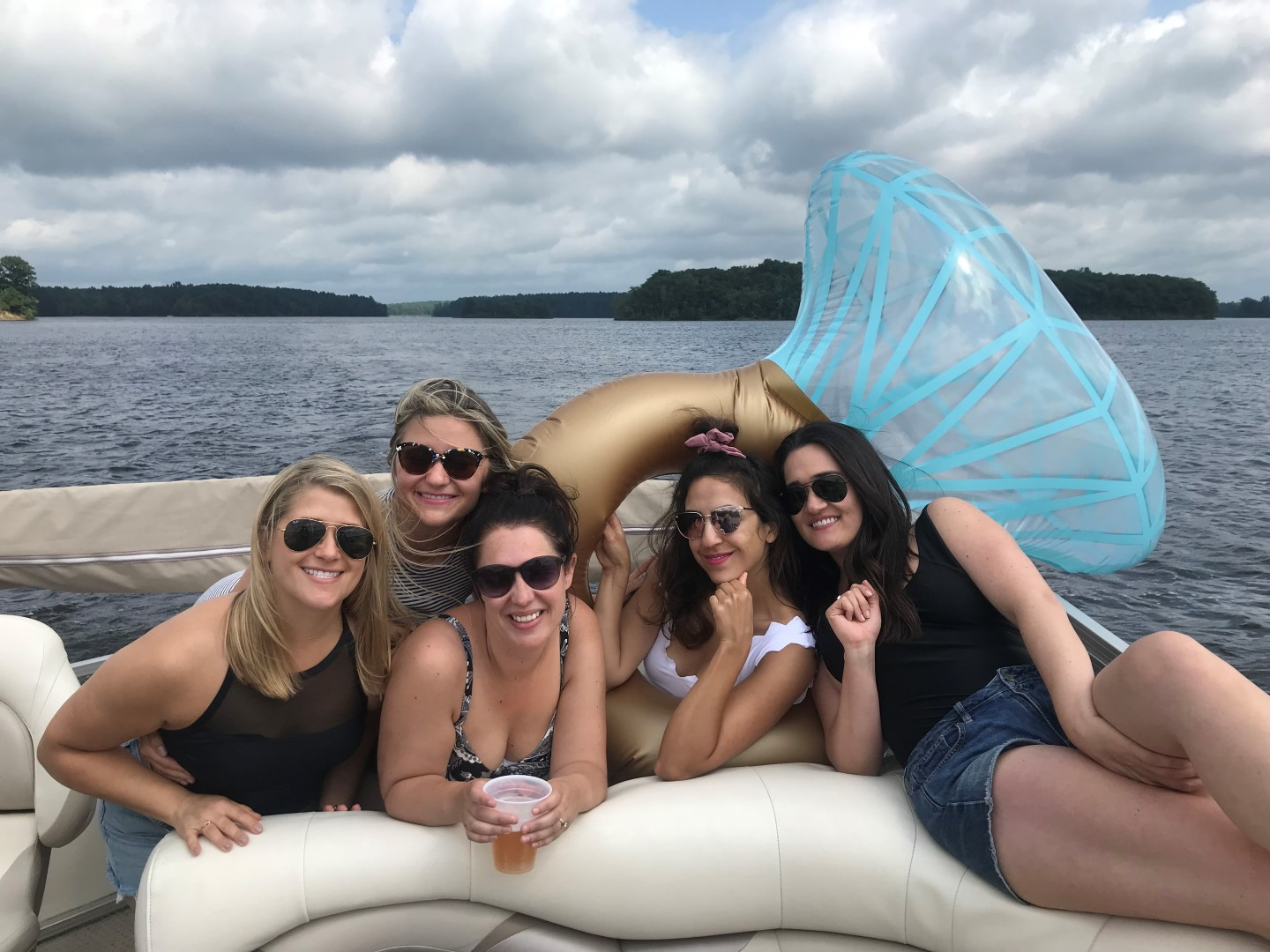 Girlfriends with diamond ring pool float.
