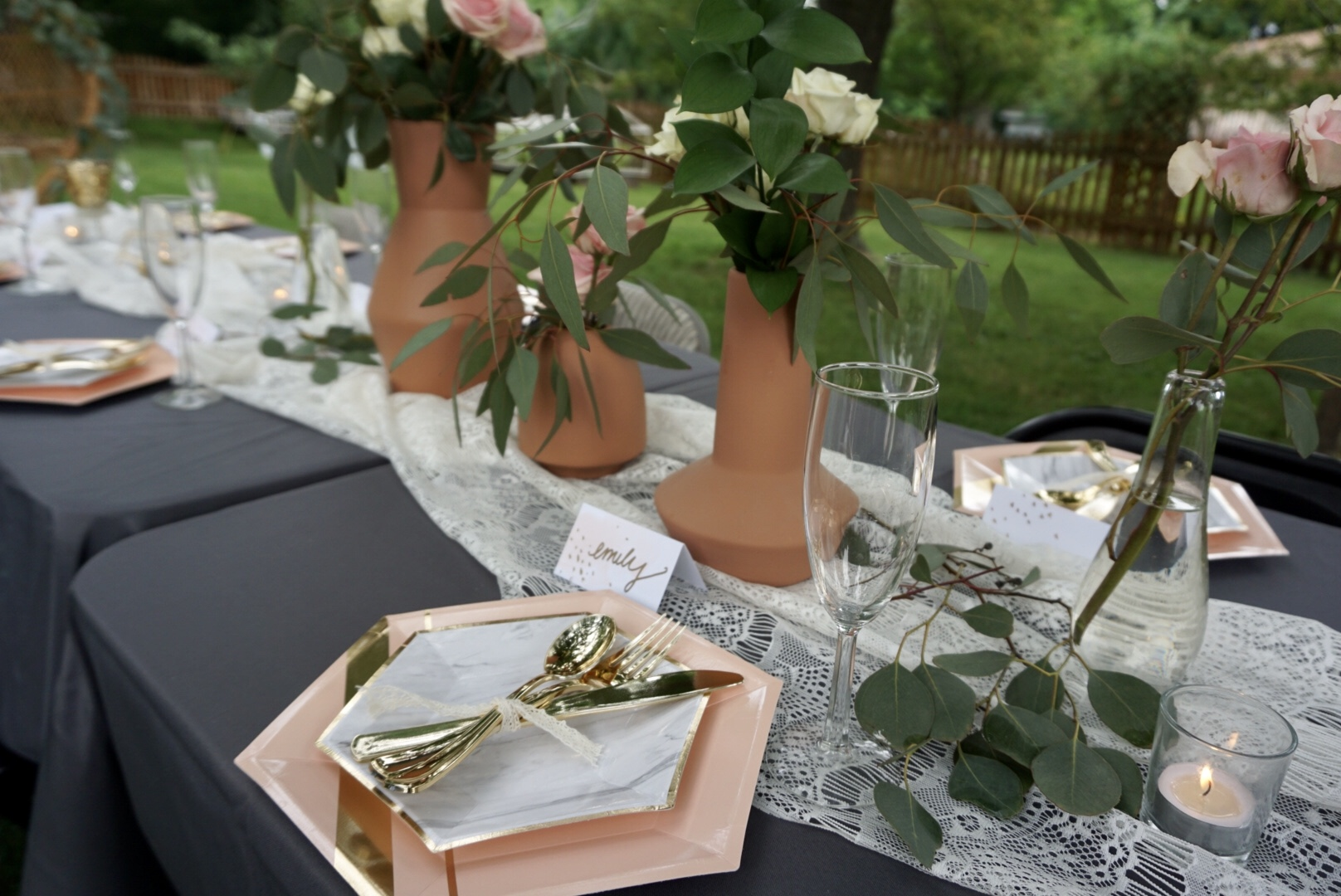Rosé Before the Big Day bridal shower with pink and gold table settings.