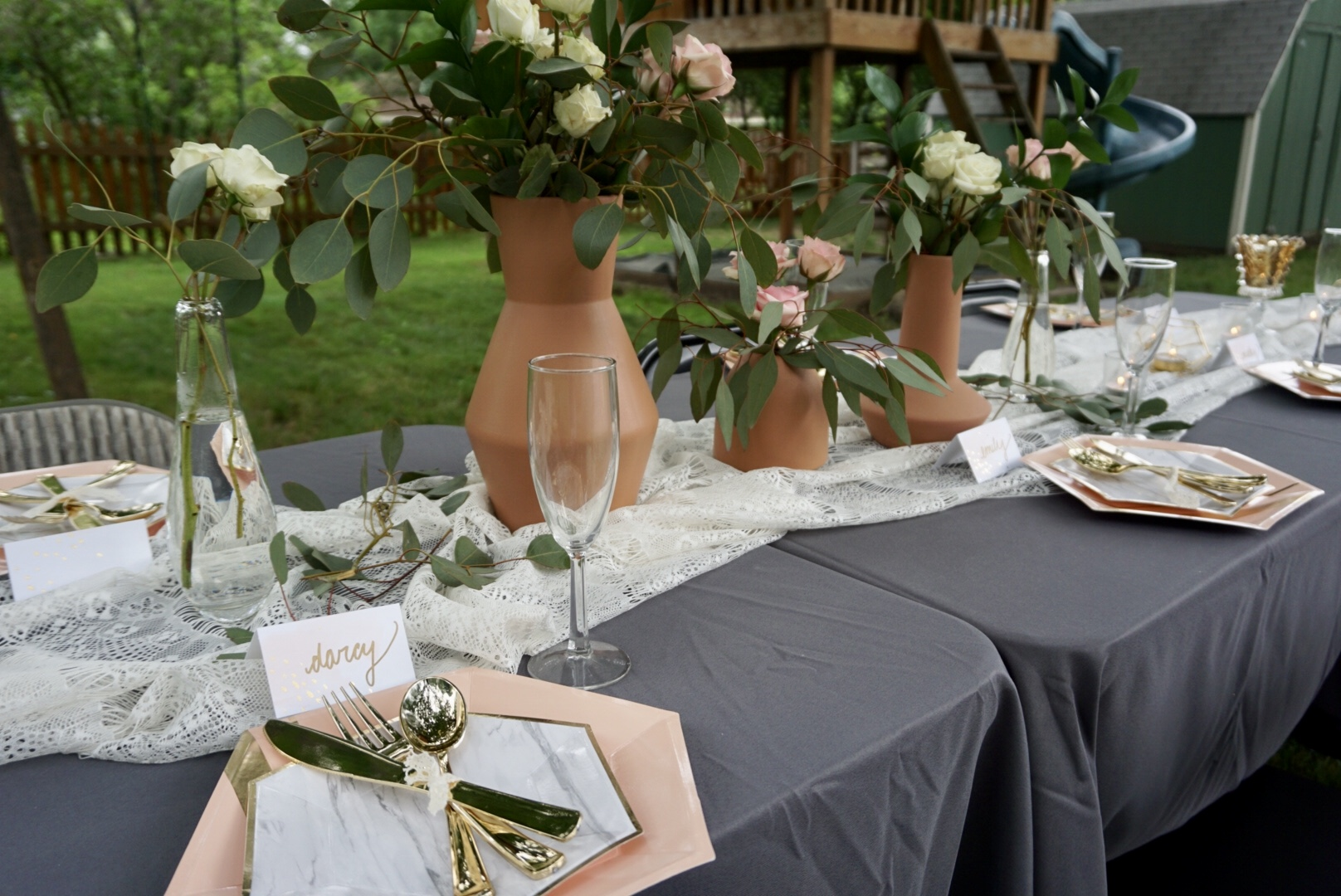Fresh floral as centerpieces at boho bridal shower.