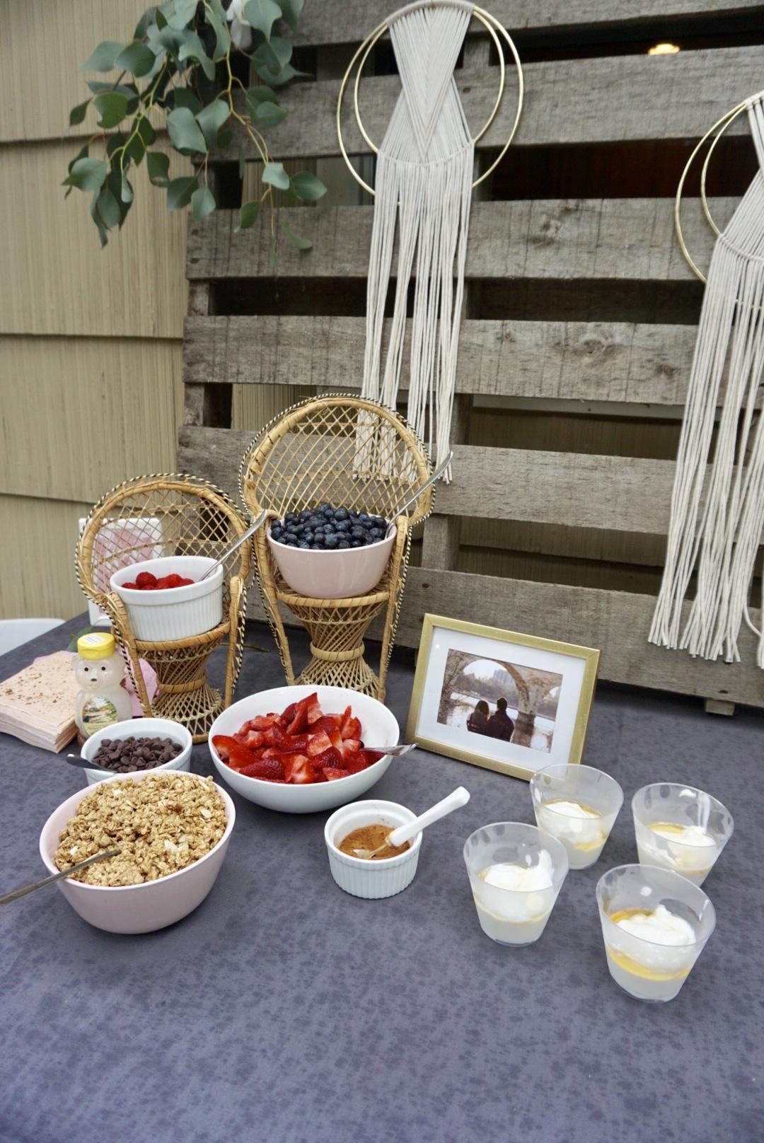 Pallets,  eucalyptus, and hoop decor for a boho bridal shower table.