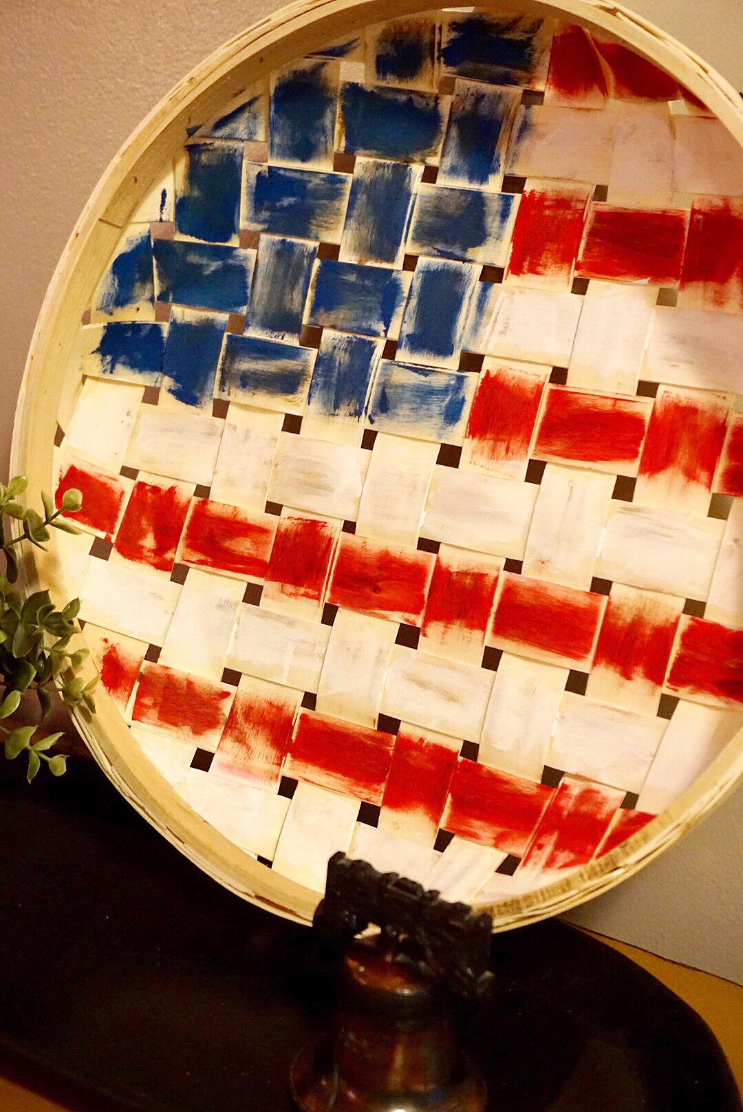 DIY 4th of July flag decor made with a basket and red, white, and blue chalk paint.