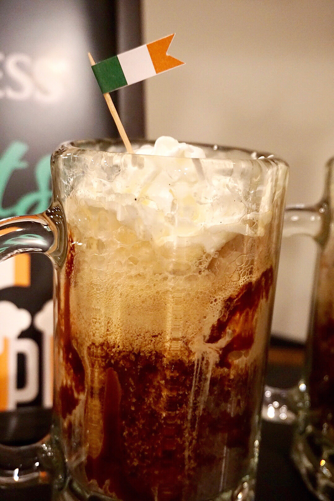 Guinness floats made of coffee ice cream, Guinness, chocolate and caramel  plus a little whipped topping.