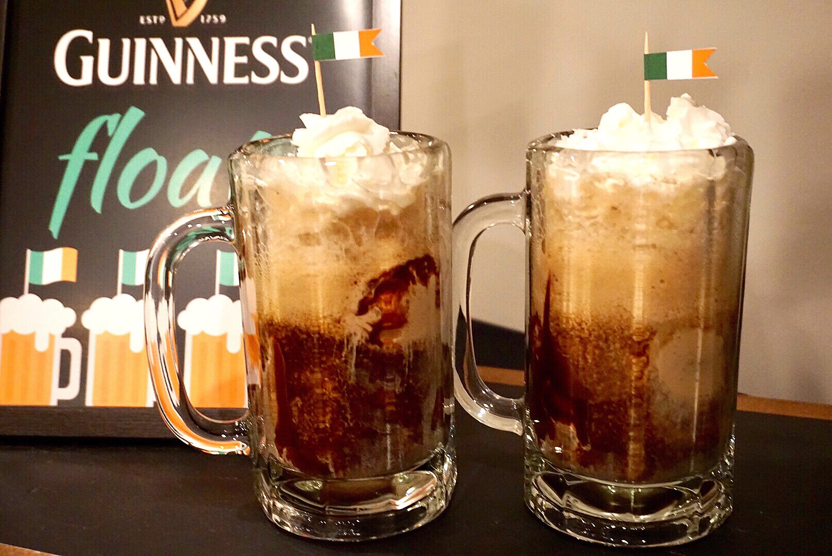 Guinness floats are a festive St. Patrick's Day drink. Add an Irish flag for a little extra fun!