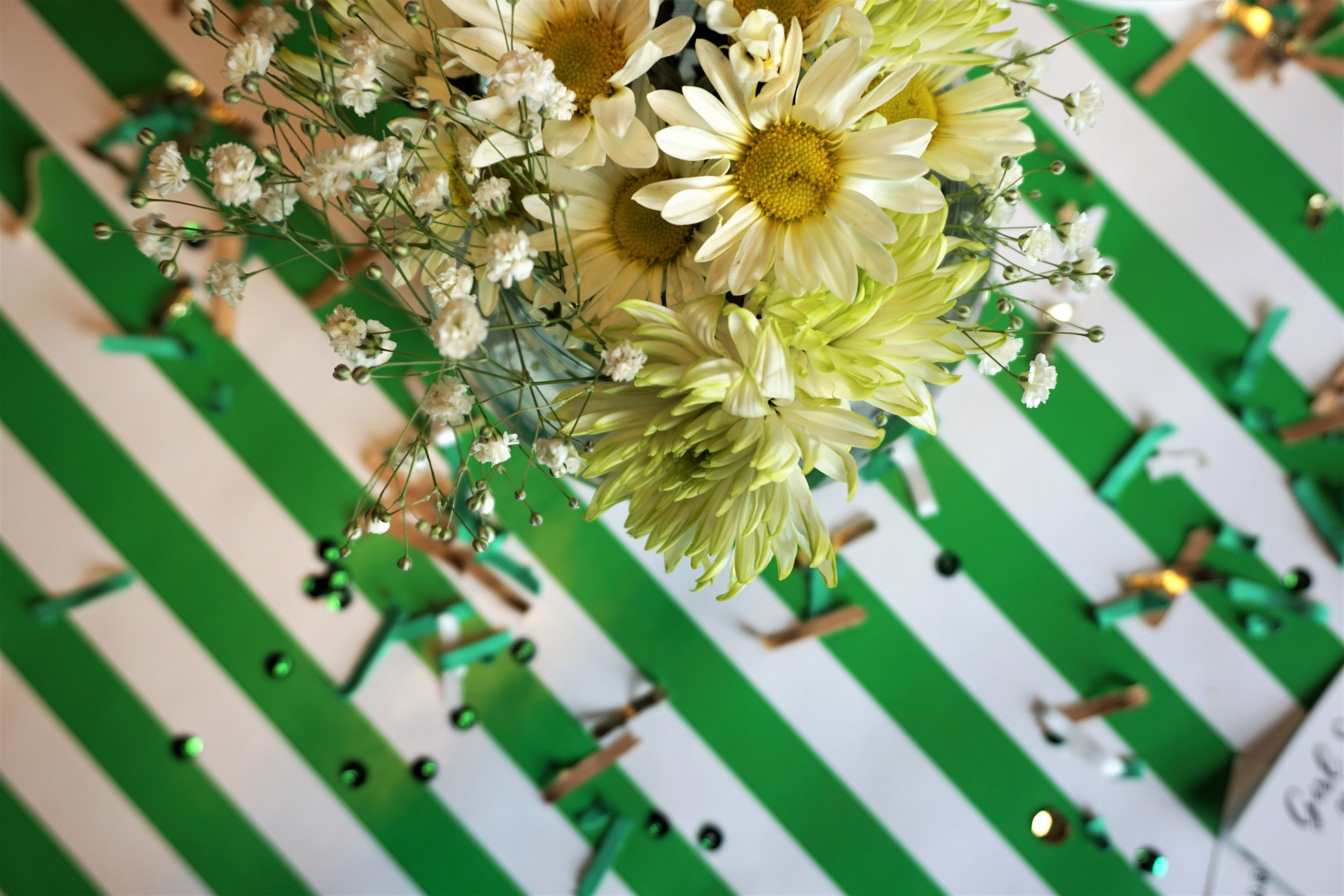 Daisy floral and green and gold confetti for a Girl Scout party.