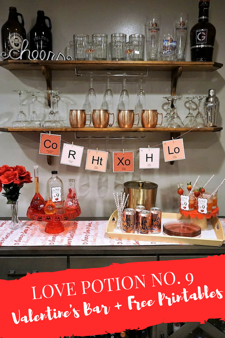 Mix up some Love Potion No. 9 with this themed Valentine's bar. Click here to get the details and download the free printable banner! #valentinesday #valentinedecor #valentinecocktail #valentinebar #freeprintable #printablebanner #valentinebanner