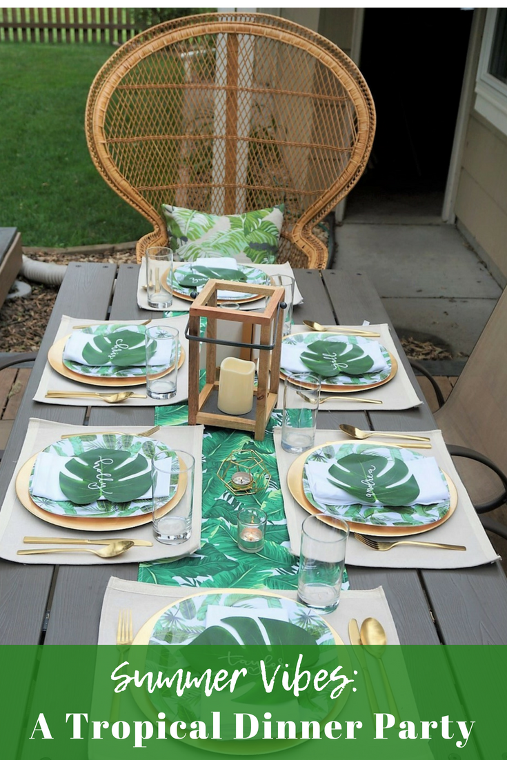 Throw the perfect summer dinner party with tropical vibes! Click here for some easy ideas and you'll be surprised to learn you can find so many items for your summer party at the dollar store! #summerparty #summerentertaining #tropicalparty #summervibes #summerparty #tropicaltheme