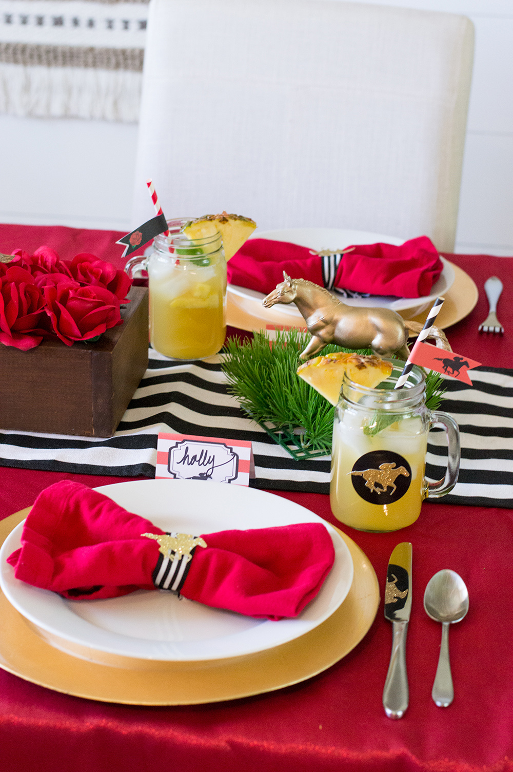 Bow tie red linen napkins with black and white ribbon make a perfect addition to a Kentucky Derby place setting.