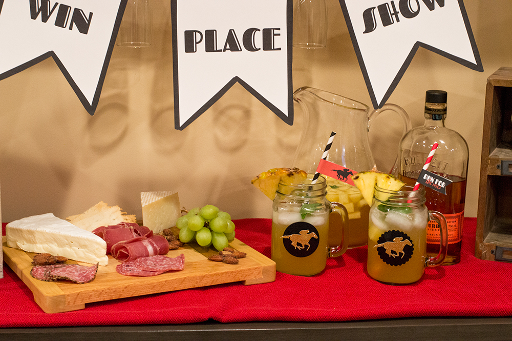 Mint julep sangria and a meat and cheese board make great snacks during the Kentucky Derby.