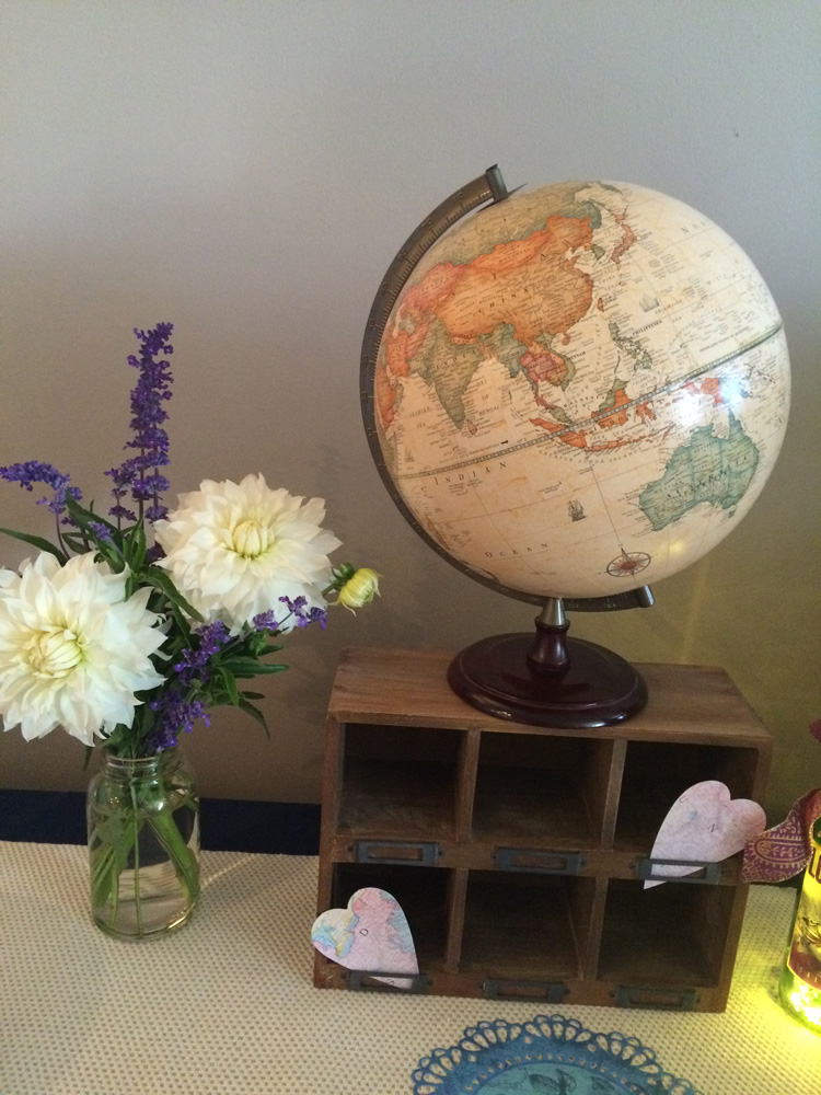 A globe and wood box make great decor for a travel themed bridal shower.