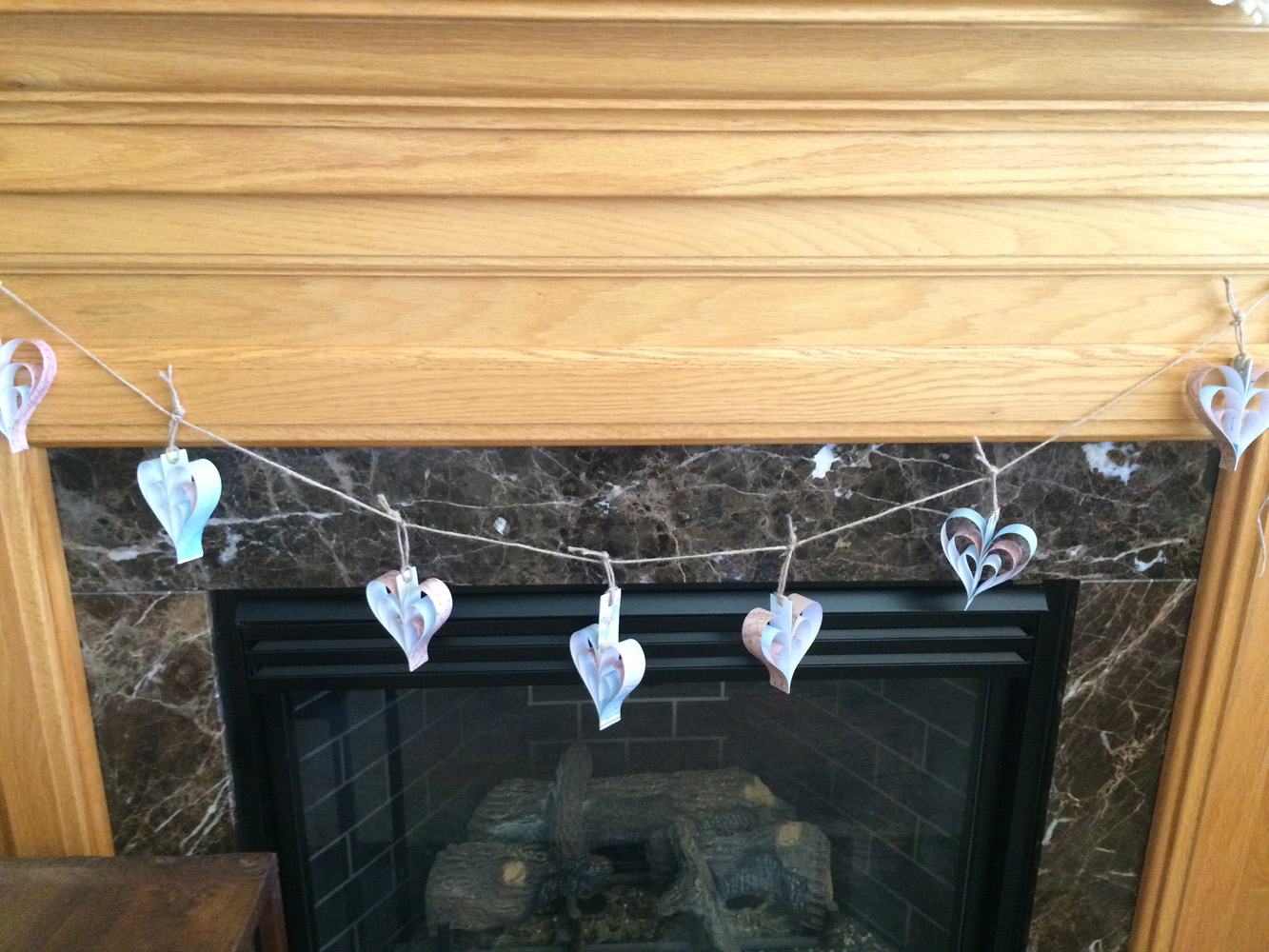 Use vintage maps or map paper to create a heart garland for a travel themed bridal shower.