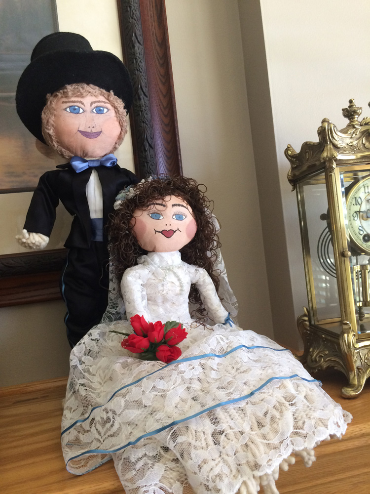 Handmade bride and groom dolls made by the groom's grandmother.