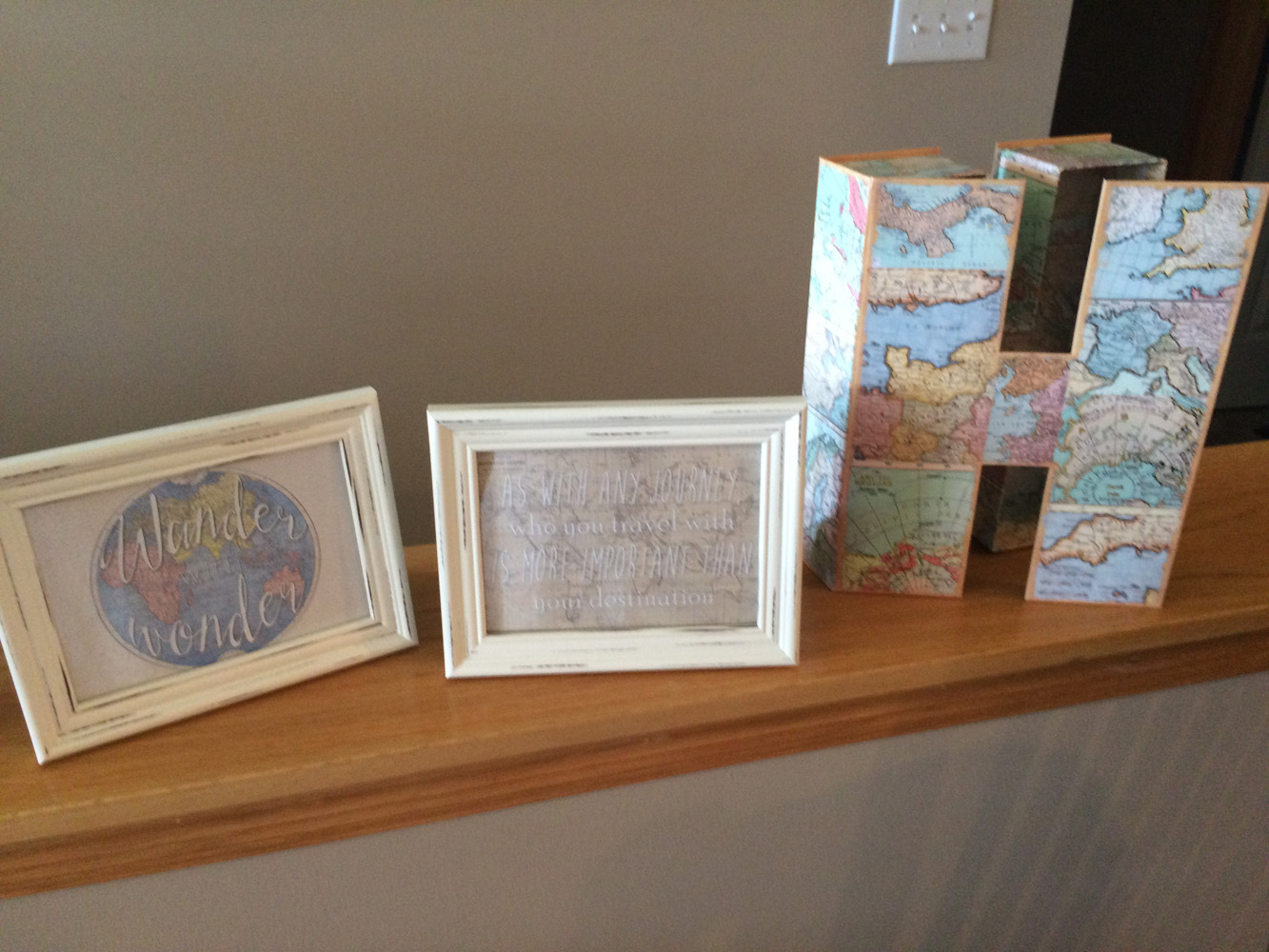 Framed travel sayings make easy decor for a travel themed bridal shower.