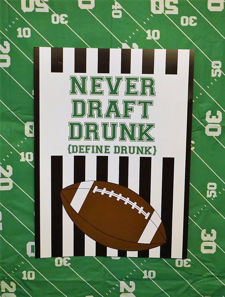 Never draft drunk printable banner for fantasy football draft party.
