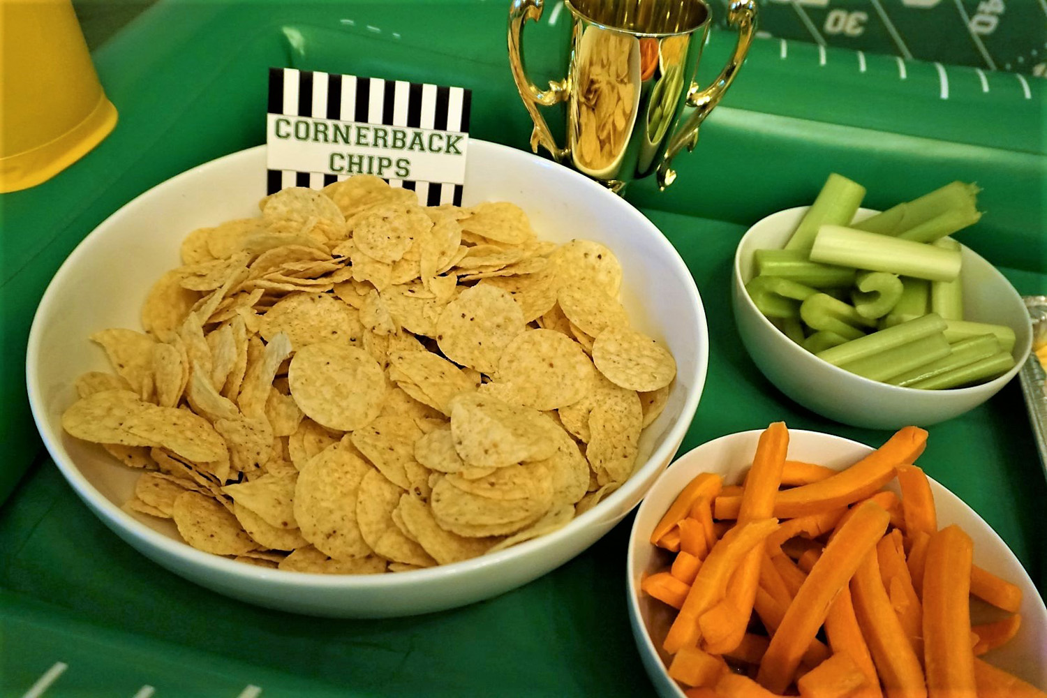 Chips, carrots, and celery make the best dippers for football snacks, especially buffalo chicken dip.
