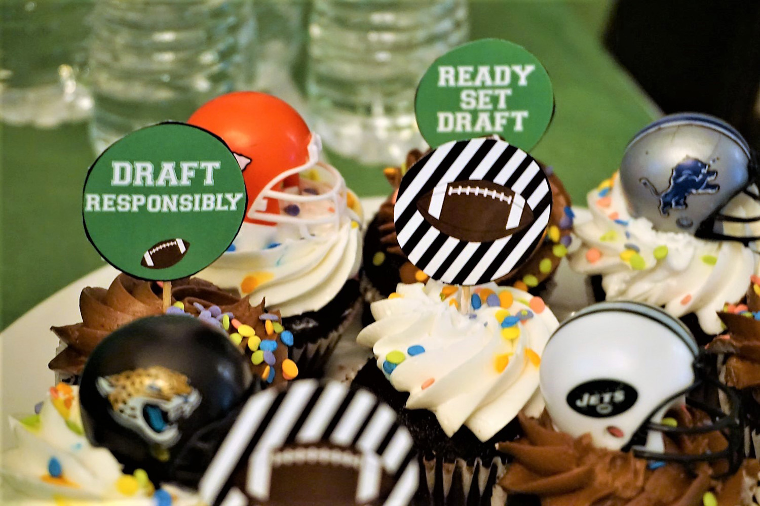 Use football themed printables to decorate cupcakes for fantasy football draft