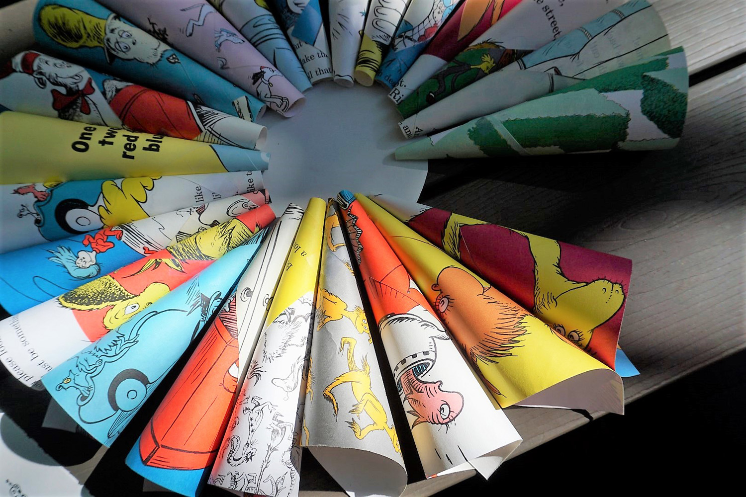 Gluing Dr. Seuss book pages to create a wreath