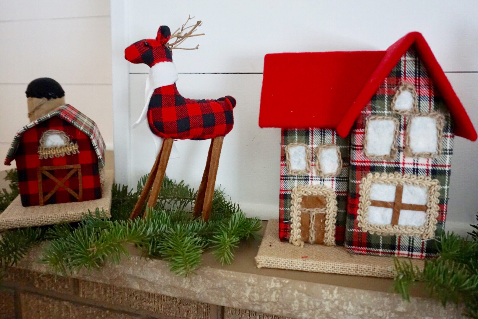 Plaid reindeer and plaid house from Walmart were the perfect add to this classic Christmas mantel.