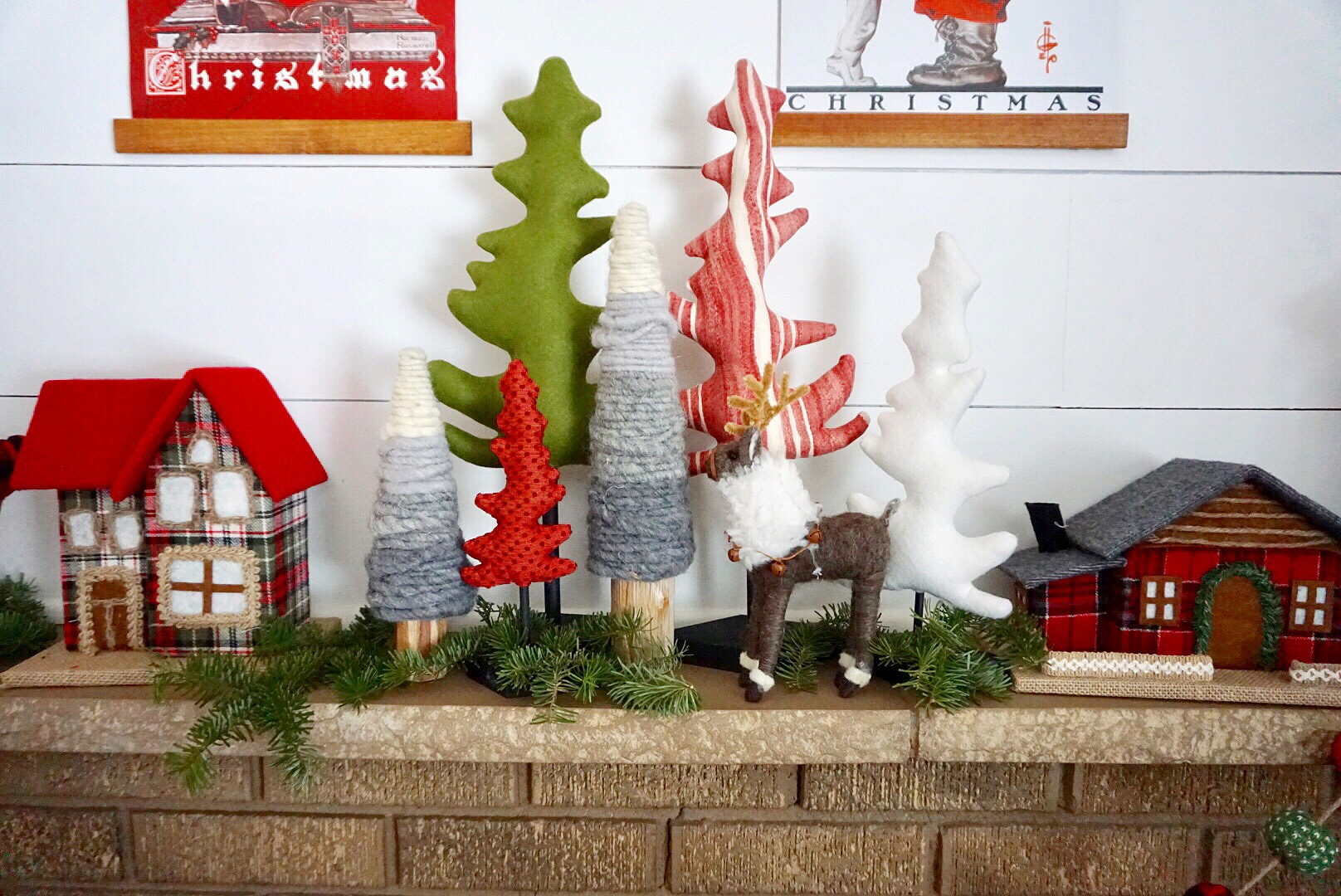 A mixture of whimsical trees, fabric reindeer, and plaid Christmas houses were perfect holiday decorations.